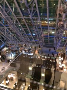 Looking down from the glass elevator